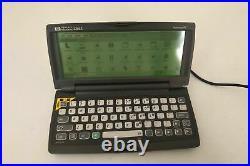 HP 320LX Palmtop PC Micro Handheld Laptop + AC Adapter Windows CE Vintage 300LX